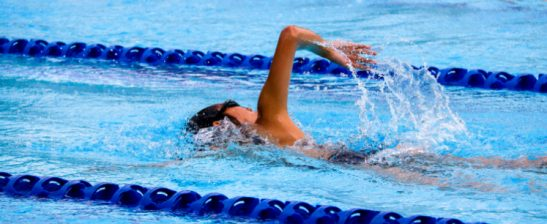 A person swims in a pool