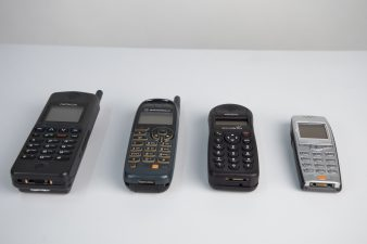 What's Changed? 27. Selection of mobile phones and black Bakelite telephone, 1940-2001