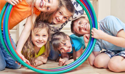 Gymnastics: recreational children smiling through hoop