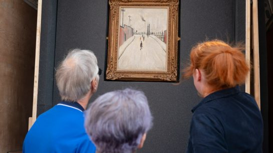 Arcon Housing residents view a Lowry painting in the back of a van that has been converted by Touchstones to take artwork out into local communities